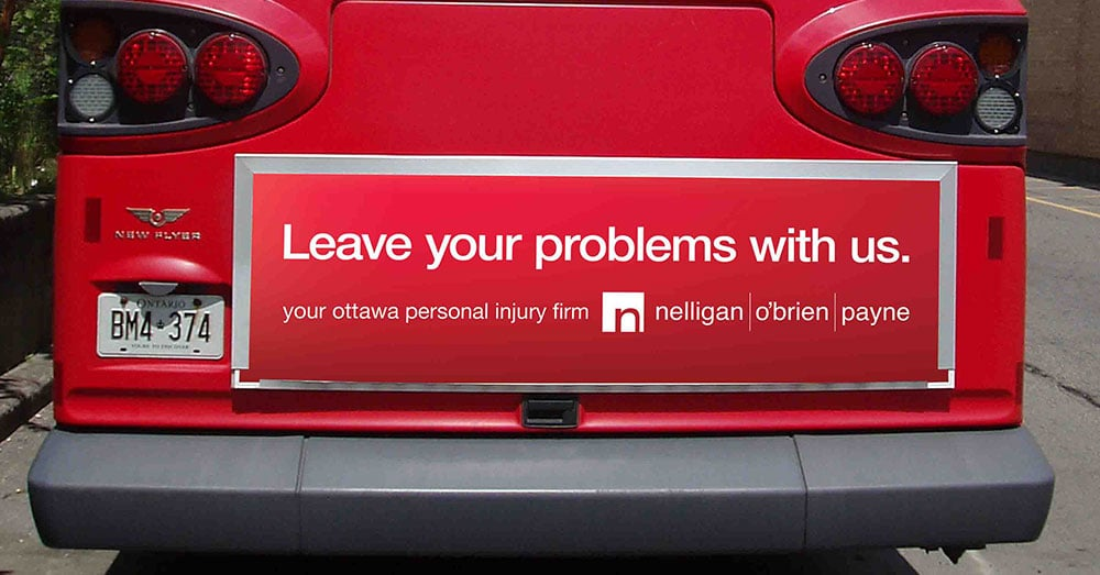 Leave Your Problems With Us - banner on the bus